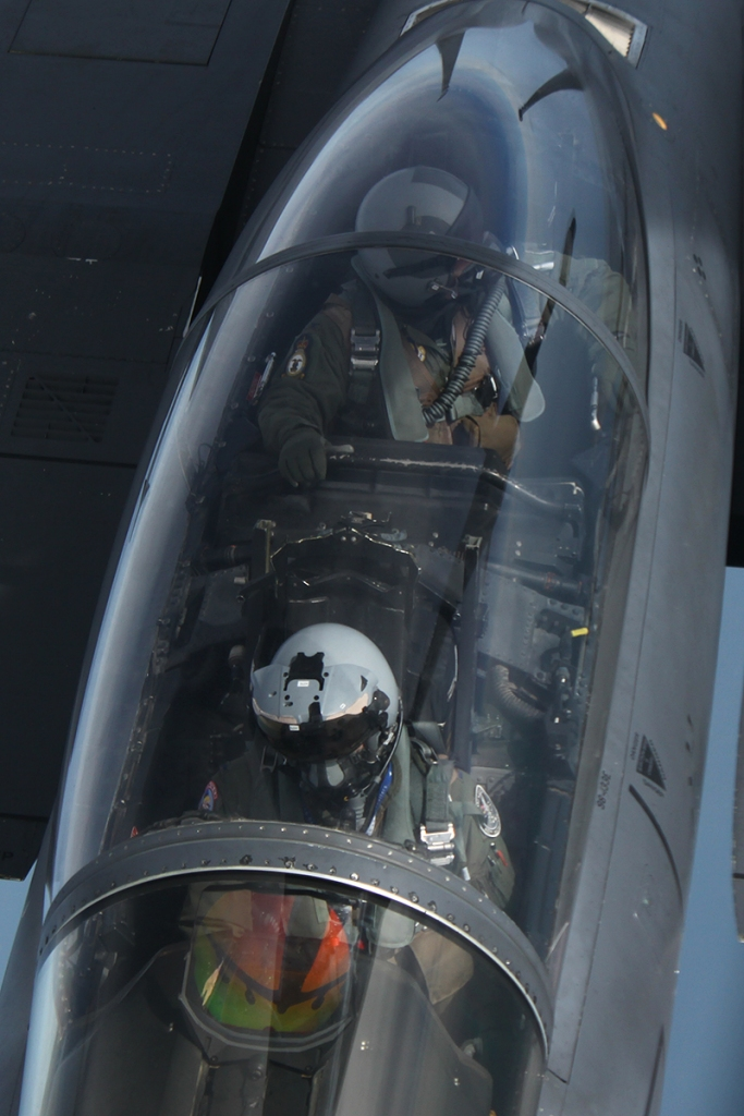 The pilot is concentrating on the guiding points under the aircraft to ensure the aircraft is on the right course. The WSO watches for connection with the boom.