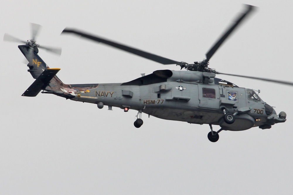 This HSM-77 Sabrehawks MH-60R is part of Carrier Air Wing Five (CVW-5) and it was photographed at NAF Atsugi in Japan.